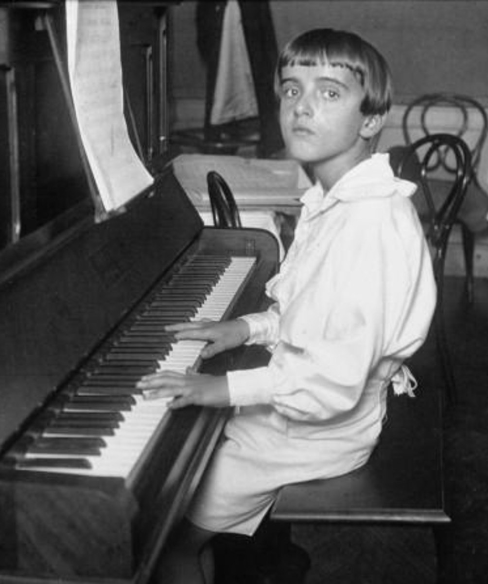 A photo of Nino Rota aged about 12 years of age playing the piano.