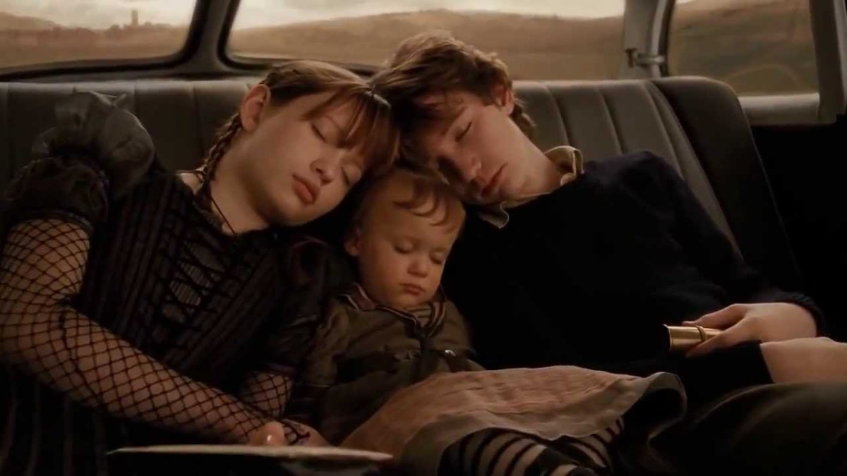 The Baudelaire orphans fall asleep.