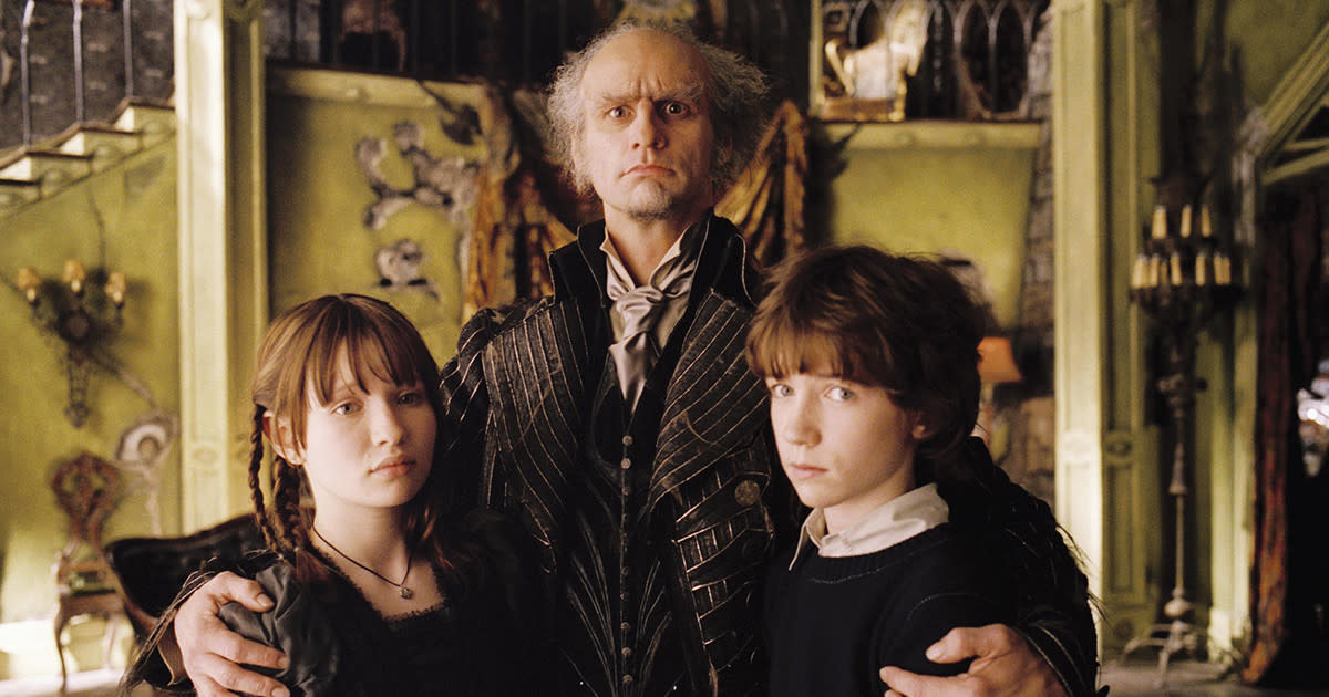 Violet and Klaus stand miserably with Count Olaf.