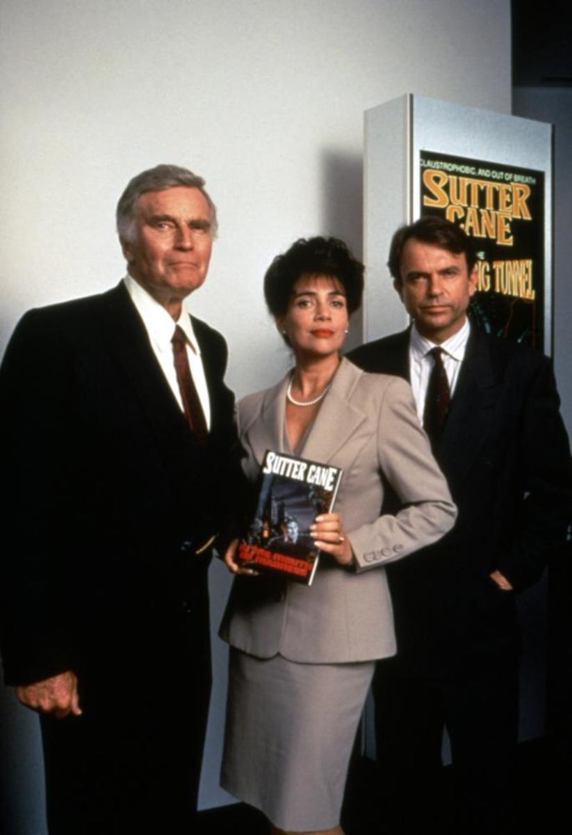 Charlton Heston, Julie Carmen and Sam Neill in a promotional photo