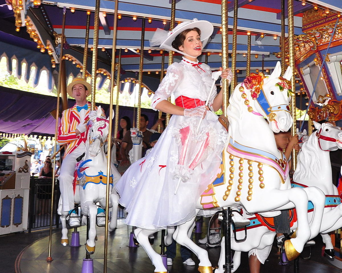 An actress and actor portray Poppins and Bert on the King Arthur Carousel at Disneyland in 2011.