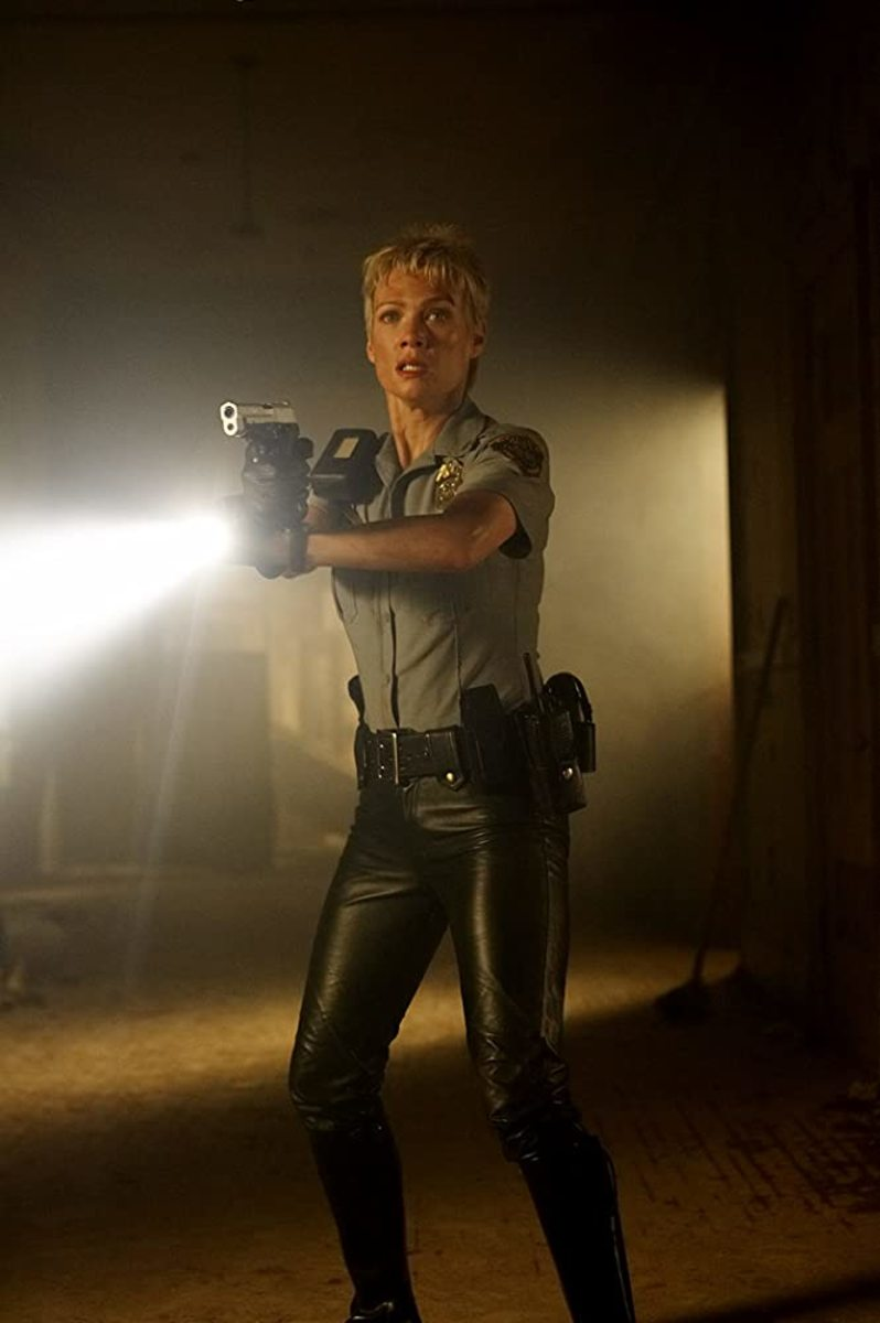 What cop goes around in skin tight leather pants? Oh... Unless she's... Hmm...