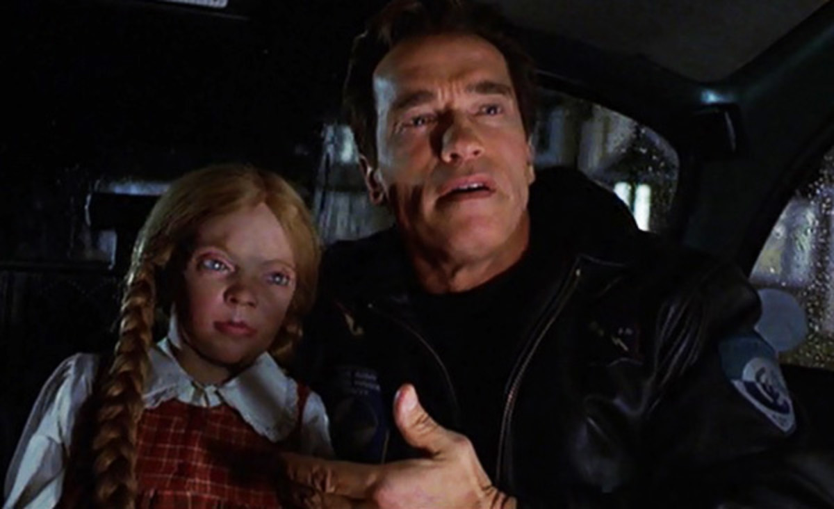 Arnold with Simpal Cindy. I would never buy that toy to my kid ; it's what nightmares are made of.