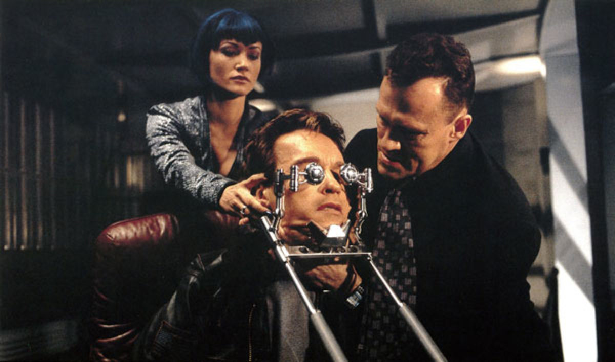 Schwarzenegger with Sarah Wynter and Michael Rooker