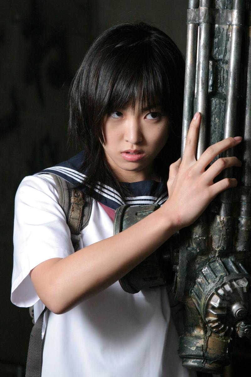 """Ami Hyuga (Minase Yashiro) and her machine gun arm in, """"The Machine Girl."""""""