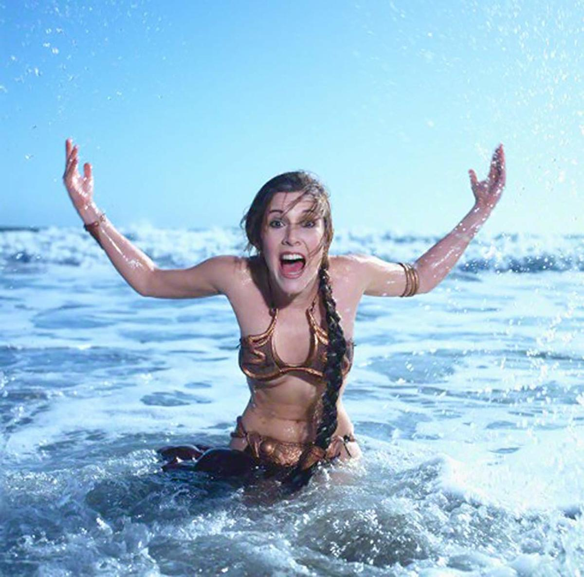 I don't know if it's inappropriate to include a photo of Fisher in a bikini to pay respects, but this picture shows her with such a fun and joyful spirit that it's hard not to be totally charmed by her in it. Rest in peace, Carrie Fisher.