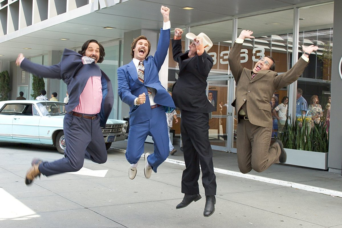 "Paul Rudd, Will Ferrell, David Koechner, and Steve Carell in, ""Anchorman: The Legend of Ron Burgundy."""