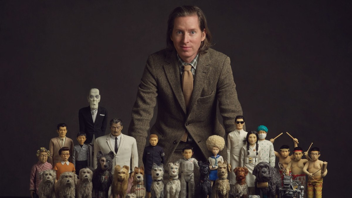 "Co-writer and director Wes Anderson with the puppet cast of, ""Isle of Dogs."""