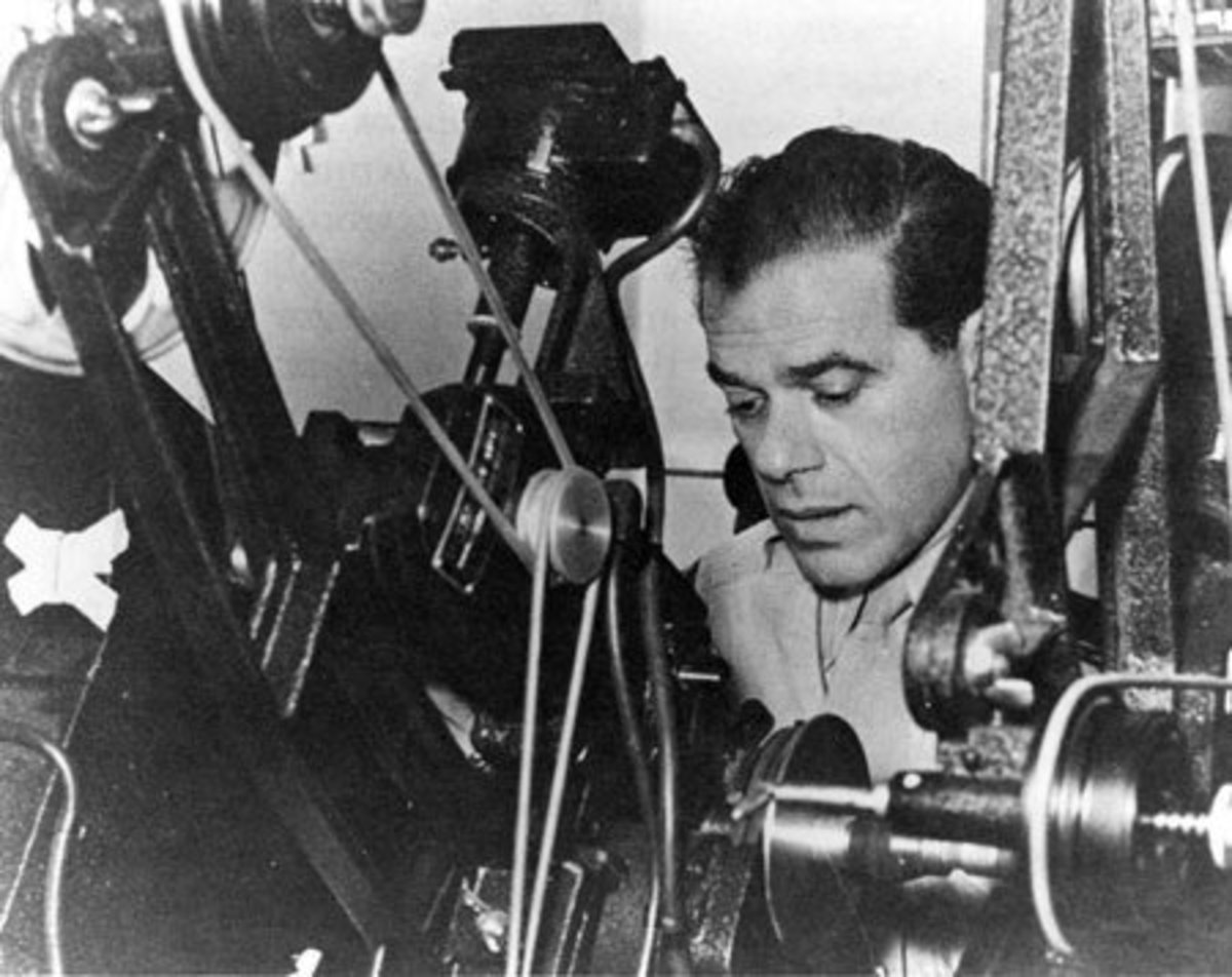 Frank Capra cuts Army film as a Signal Corps Reserve major during World War II, ca. 1943.