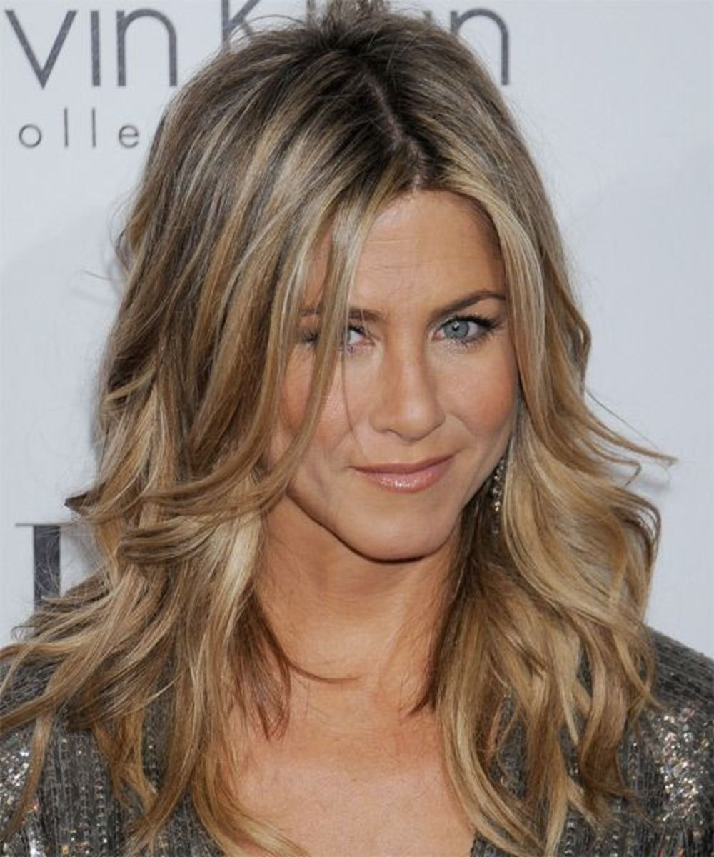Jennifer Aniston golden wavy tresses