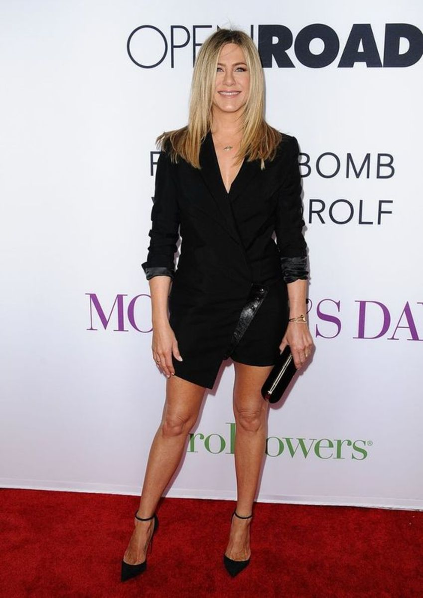 Jennifer Aniston on the red carpet in a short dress and high heels