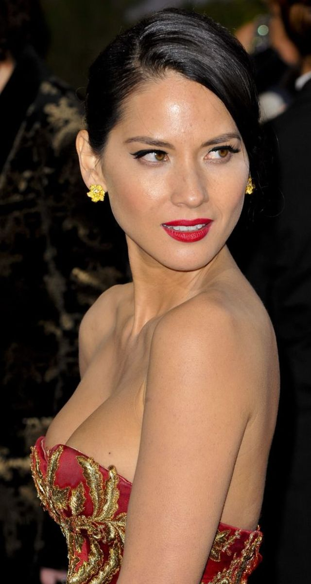 Olivia in a strapless cleavage baring gown