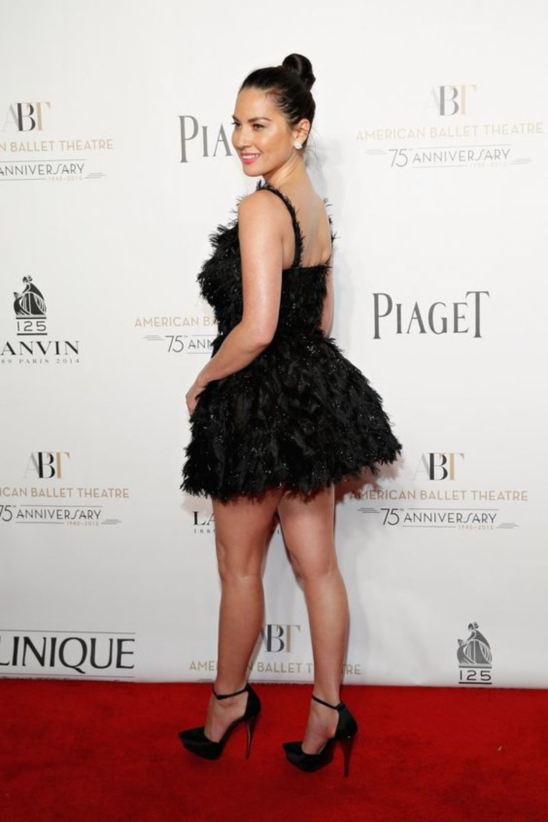 Oivia Munn wearing a short ballerina inspired dress and sky high heels showing of her stunning legs on the red carpet