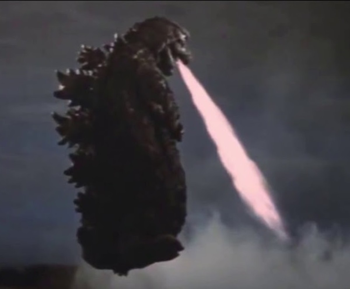 Godzilla flying with his atomic breath