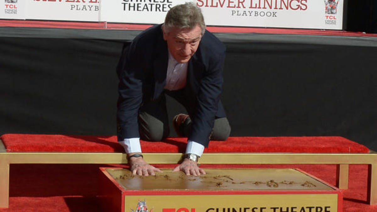 Robert DeNiro leaves his hand and shoe marks outside TCL Chinese Theatre.