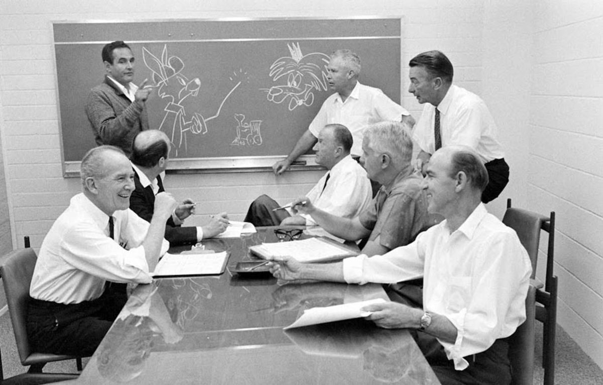 A story meeting of the Hanna-Barbera writers and head animators during the early 60's