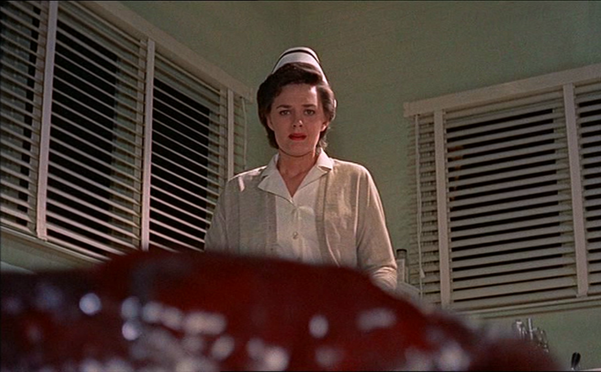 Nurse Kate (Lee Payton) attacked by the blob