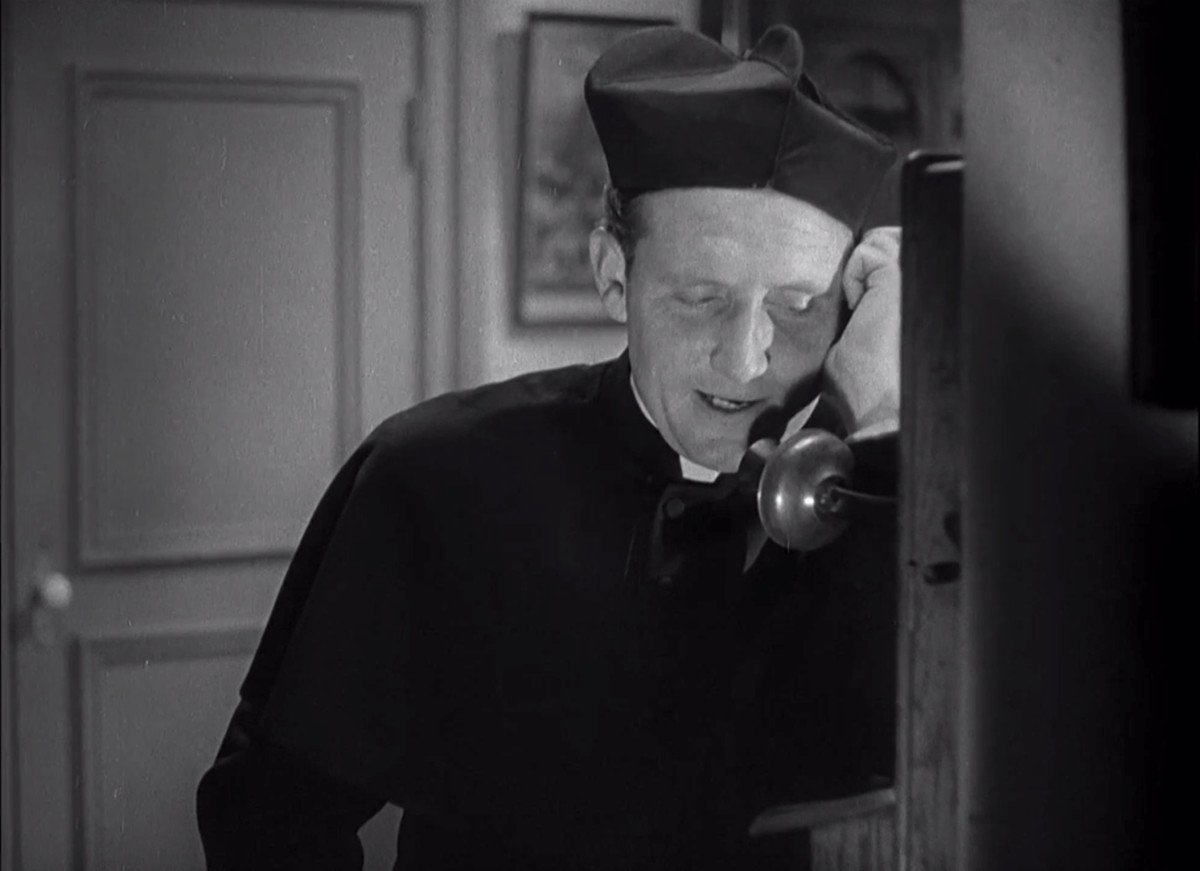 Spencer Tracy as Father Tim Mullen in San Francisco
