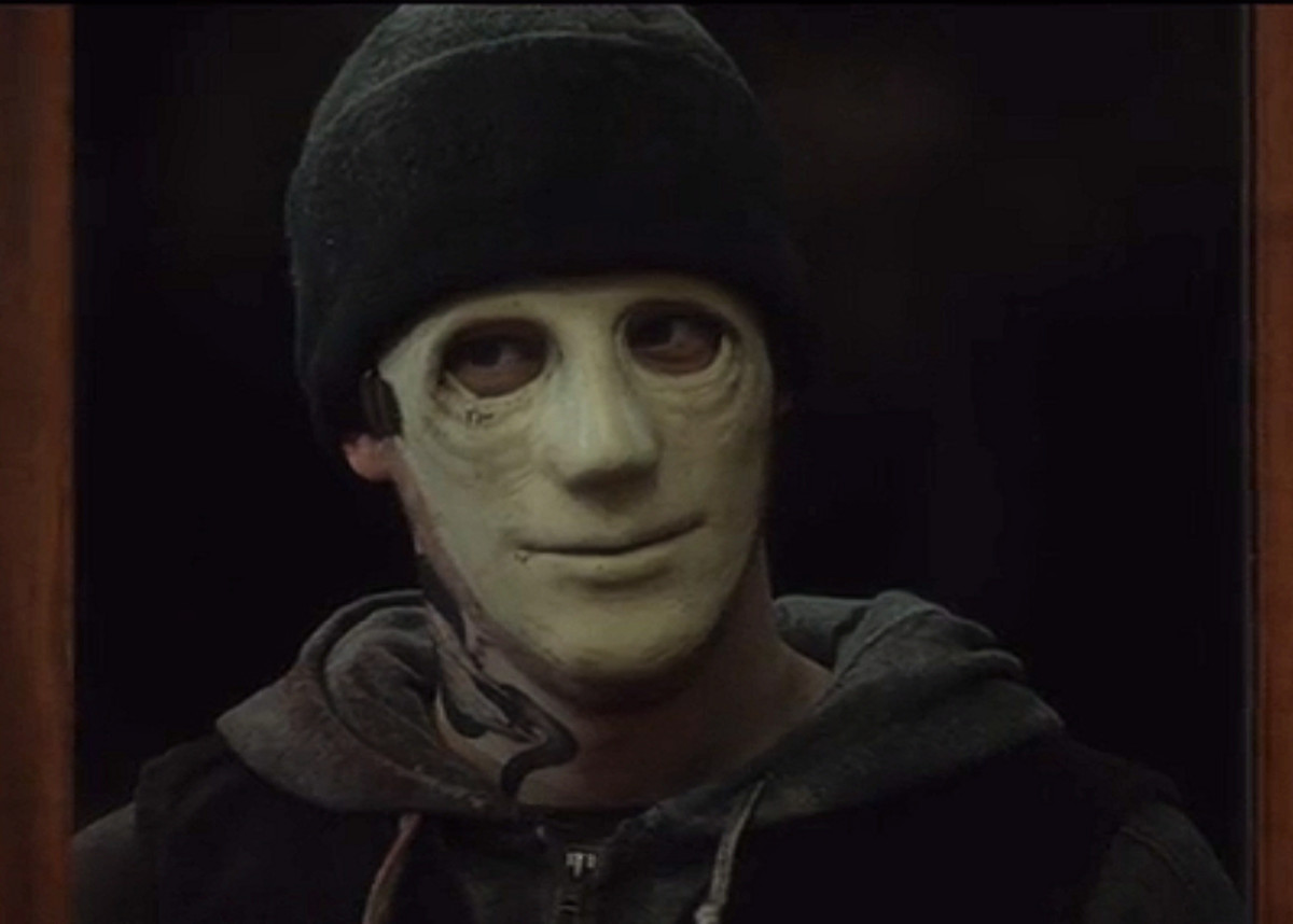 John Gallagher Jr as the Killer in 'Hush' (2016) on Netflix.