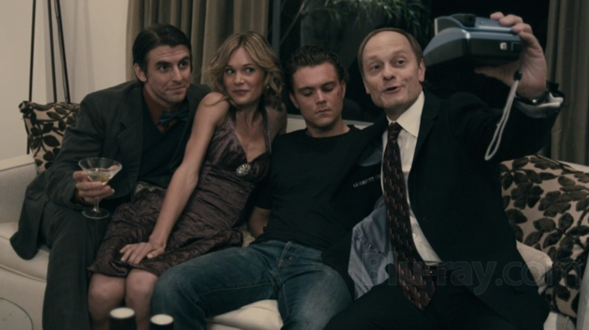 David Hyde Pierce and Clayne Crawford getting cozy with guests in The Perfect Host.