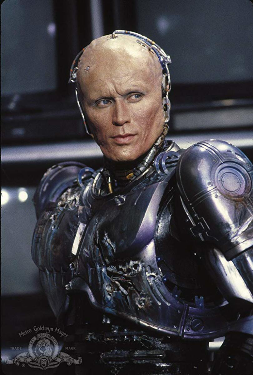 Peter Weller as Big Mechanical Bald Baby.
