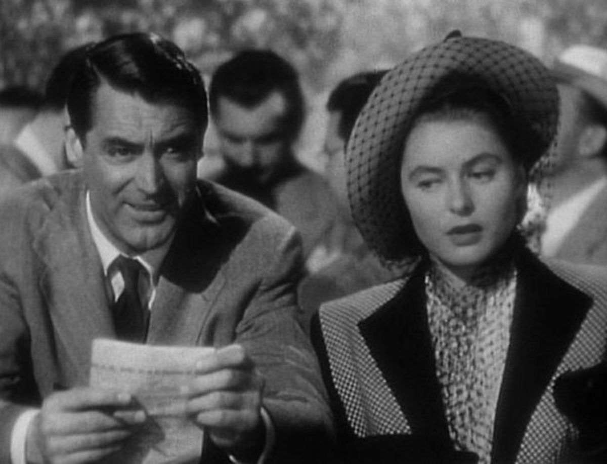 Cary Grant and Ingrid Bergman play their characters at the racetrack.