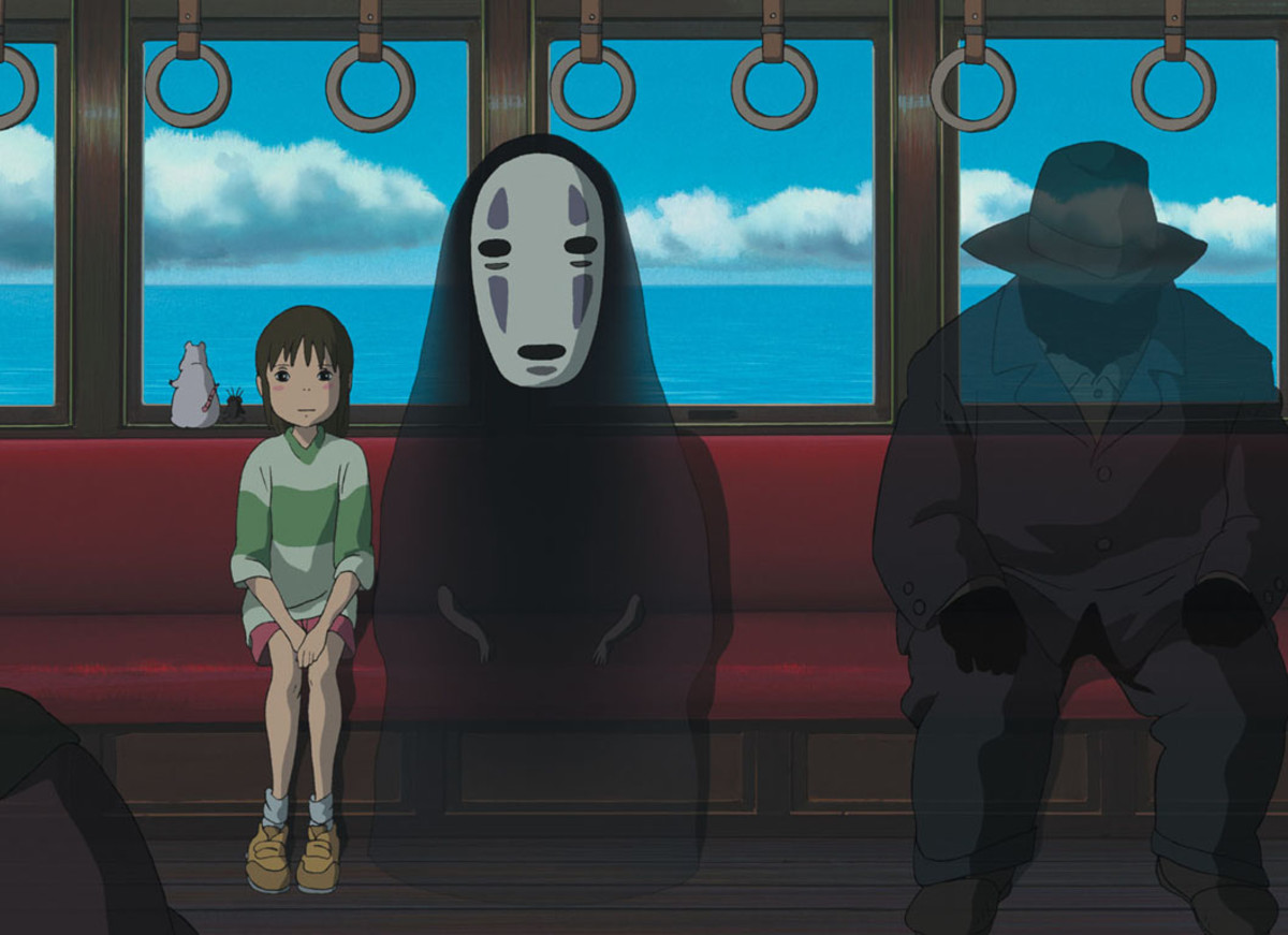 The character of No Face (centre) demonstrates the film's ability to be child-like, enigmatic and genuinely terrifying in equal measures