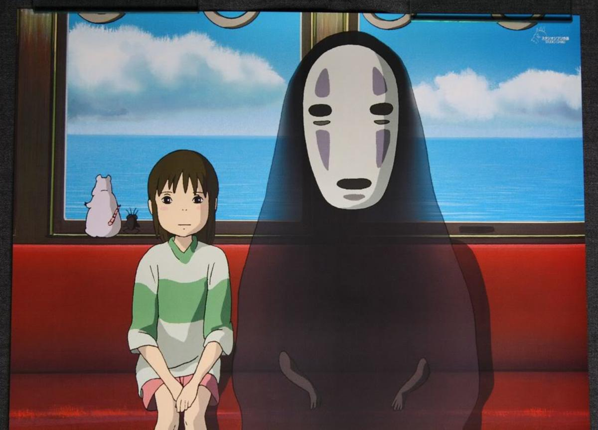 Chihiro and Kaonashi (No-Face) taking a train to Zeniba's residence