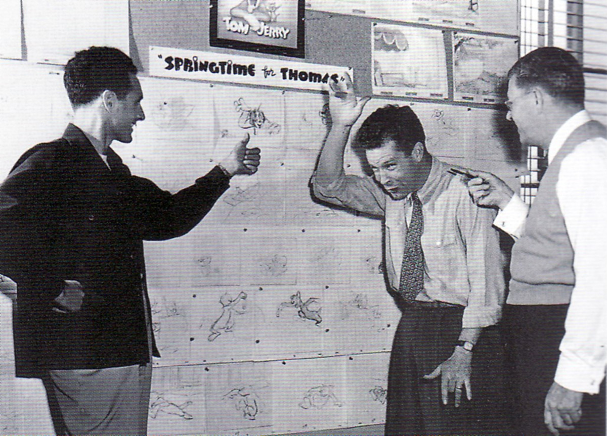 Joseph Barbera (left) and William Hanna (center) going through a Tom & Jerry storyboard with Fred Quimby (right)