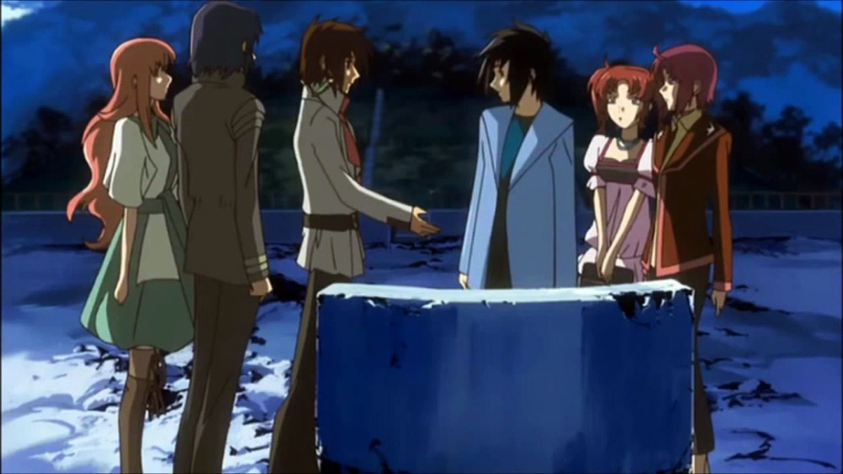 Kira extending a hand of friendship to Shinn as the others look on at the seaside memorial in Orb