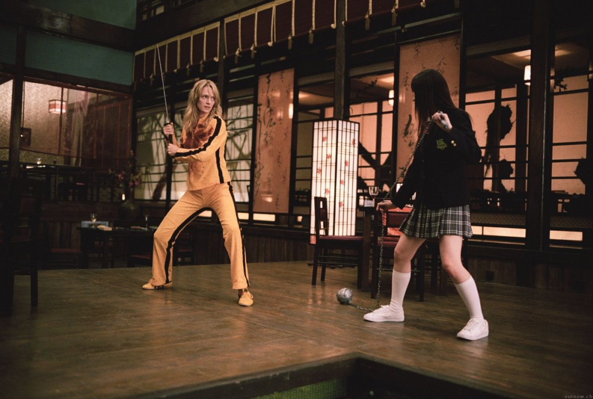Dressed to kill - Thurman (left) delivers a surprisingly assured confidence in an action role, channelling Bruce Lee through her costume.