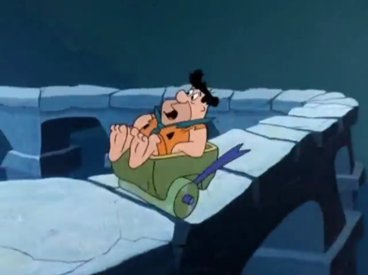 Fred in a runaway cart on a Roman acqueduct after escaping from Ali and Bobo.