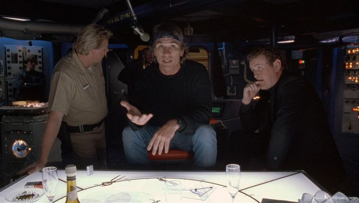 "Gary Busey (left), Tommy Lee Jones and Colm Meaney (right) in ""Under Siege"""