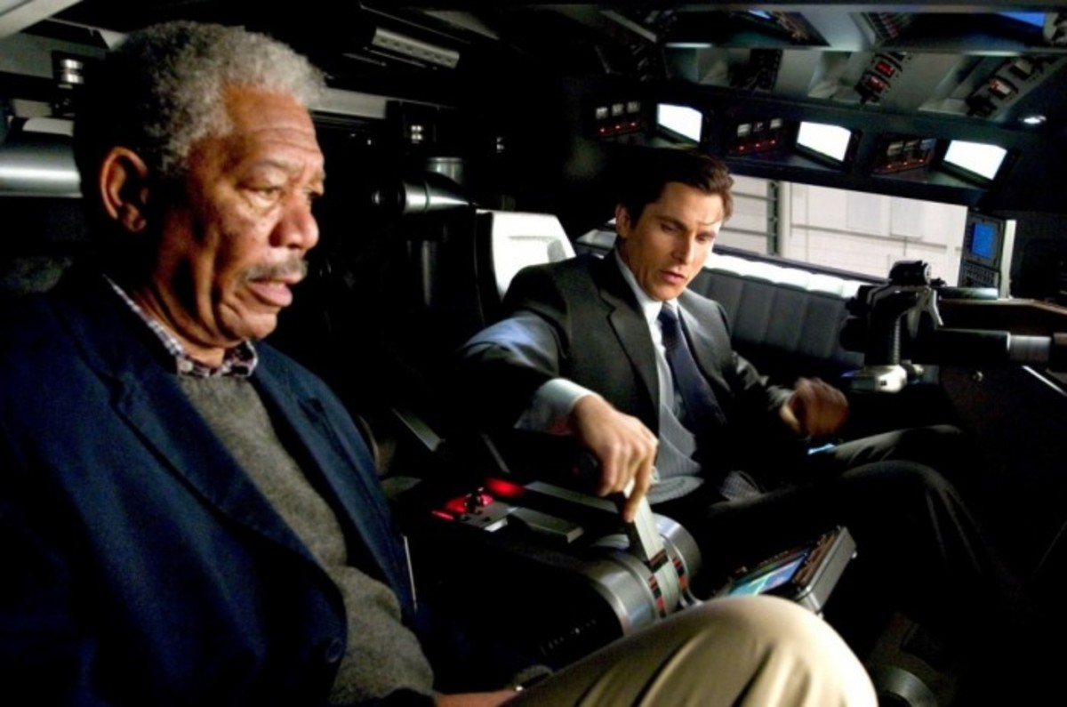 Morgan Freeman (left) shows Bale how to drive the new-look Batmobile