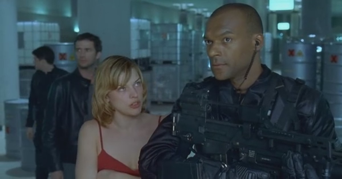 "Salmon (right) and Jovovich (centre) hear something go bump in the science lab in ""Resident Evil"""