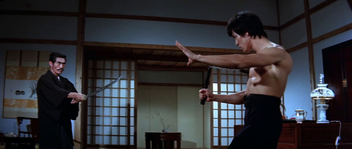 Lee (right) dominates the picture with his magnetic charisma, despite the suspect dubbing. He is undoubtedly the film's star.