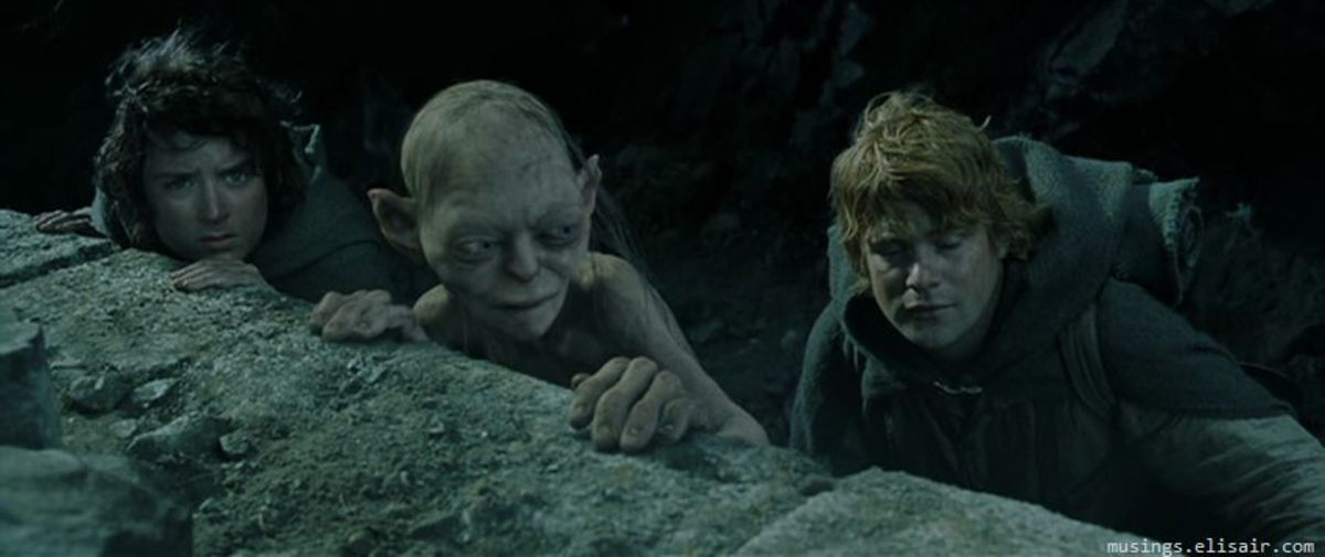 Frodo (left), Gollum and Sam (right) approach Mordor with the Ring...