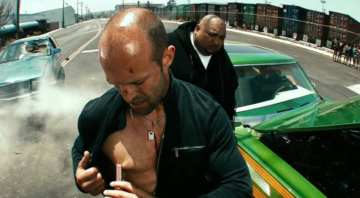 Statham (centre) returns as the apparently indestructible hitman Chev Chelios...