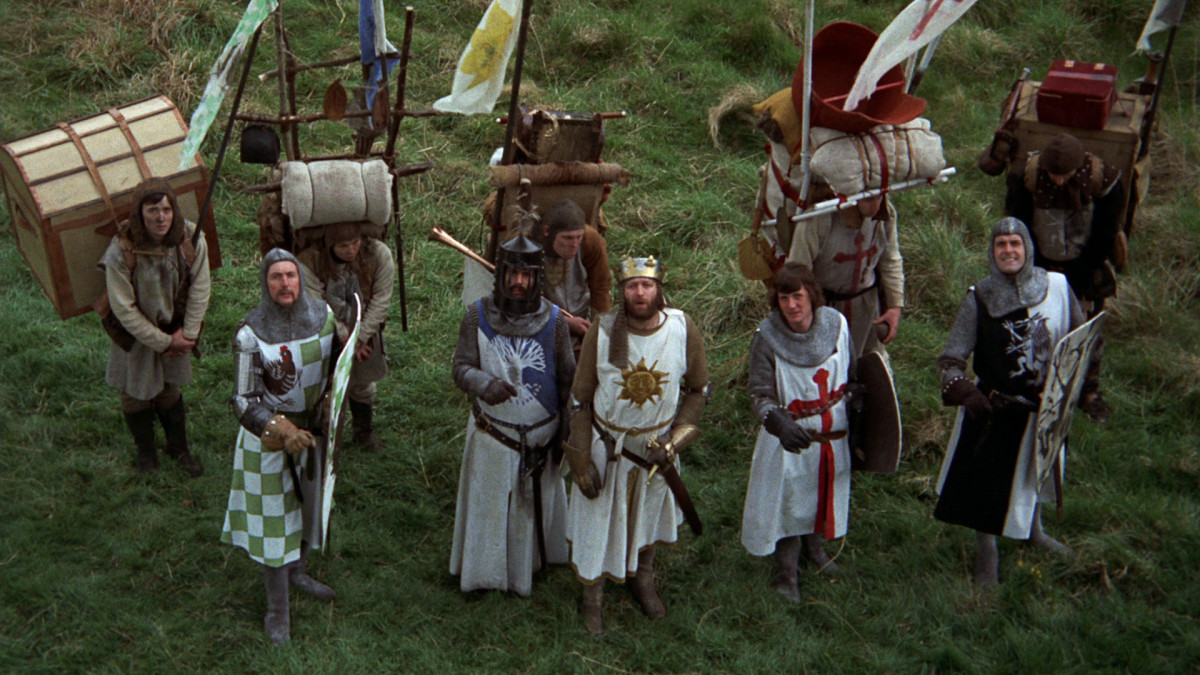 Chapman (centre) leads the Python boys on a magnificent medieval quest to find the Holy Grail... possibly.