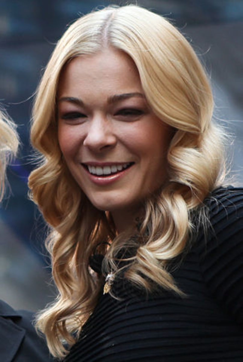 Country star Leann Rimes not only performs the film's show-stopper but also cameos
