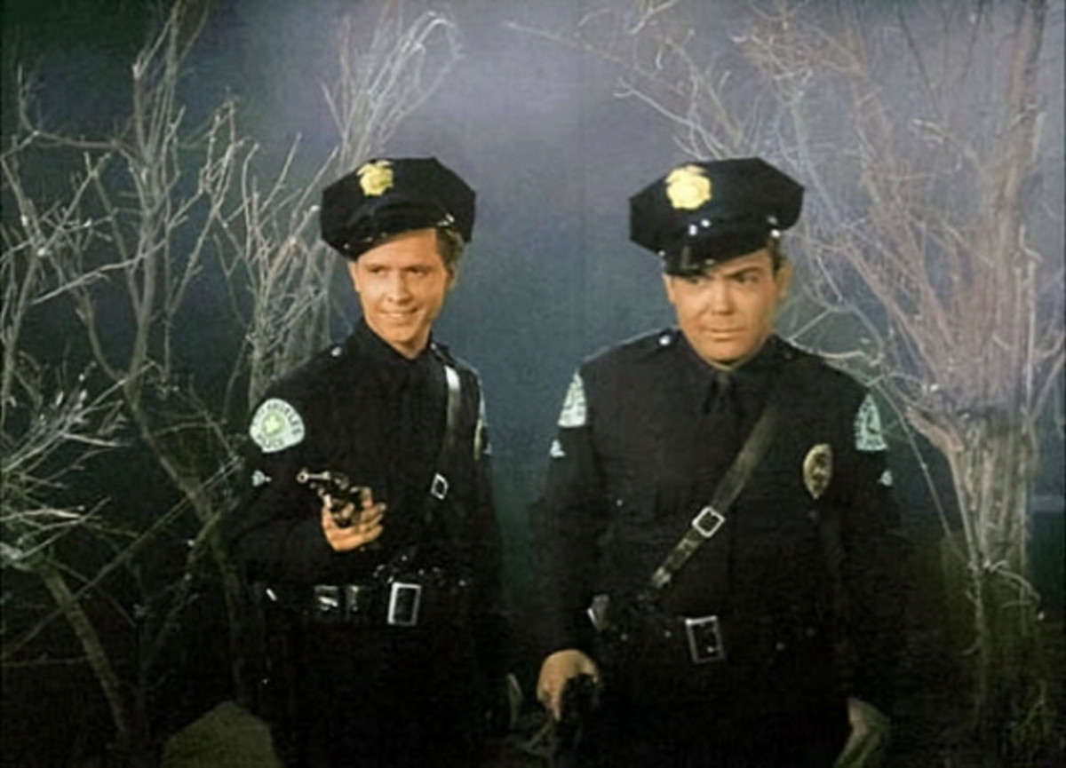 The film is actually part of a trilogy of Ed Wood films featuring Paul Marco (right) as cowardly cop Kelton.