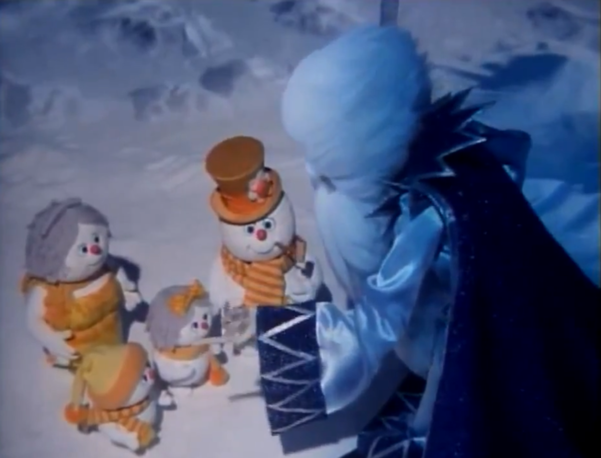 Winterbolt offering magic amulets to Frosty and family.