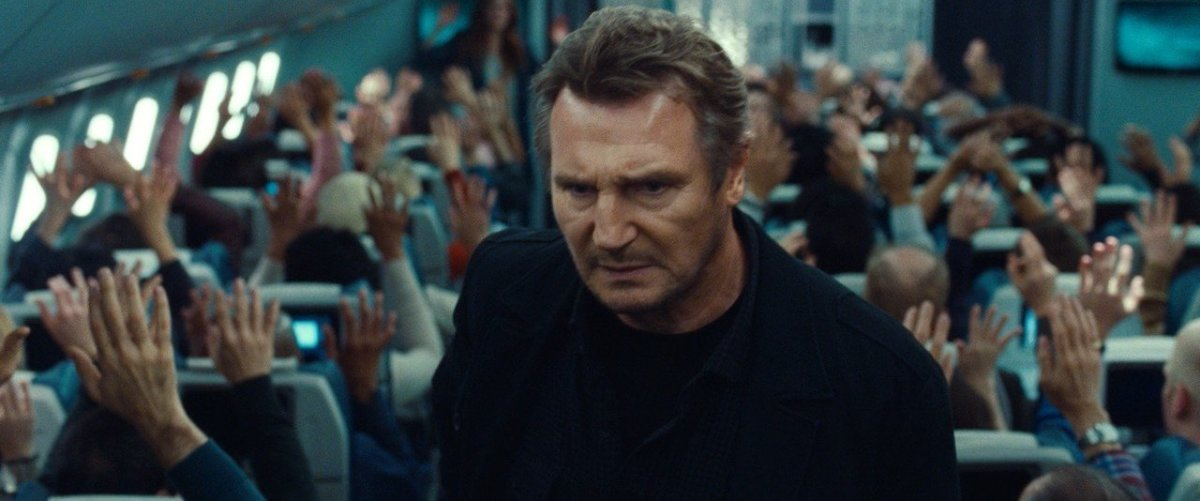 Neeson, regretting asking all the passengers if they wanted something to drink...