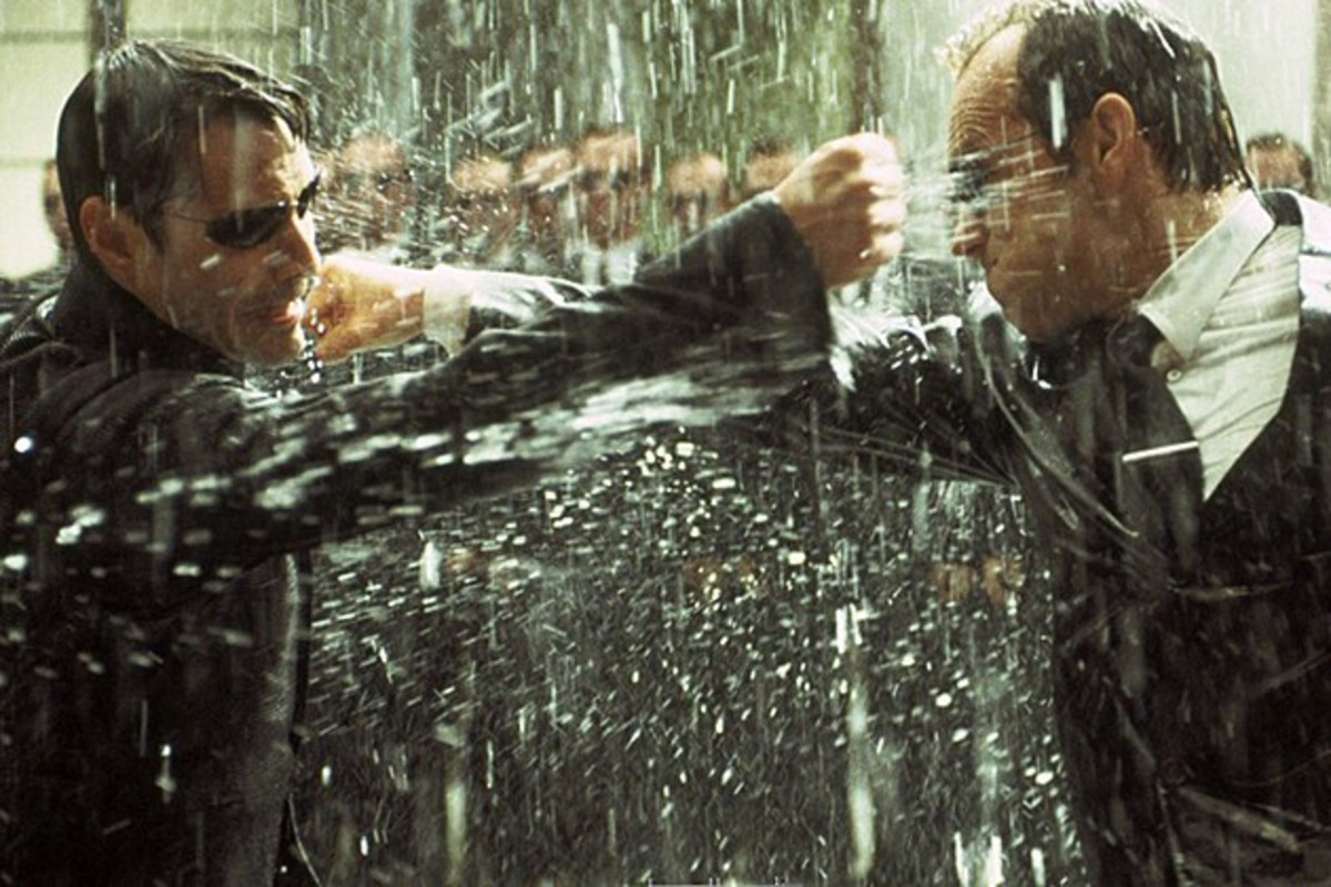 "Reeves (left) and Weaving (right) duke it out for the final time in ""The Matrix Revolutions"""