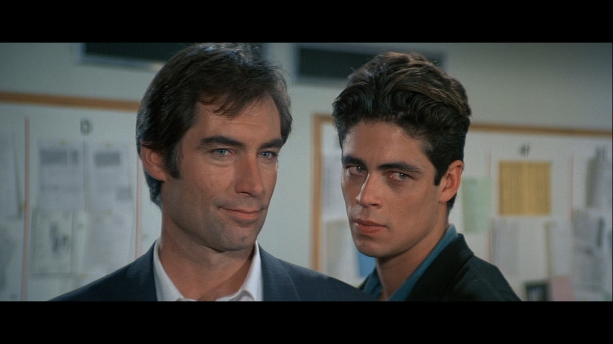 The film features Benicio Del Toro in an early role, looking impossibly fresh-faced as chief goon Dario