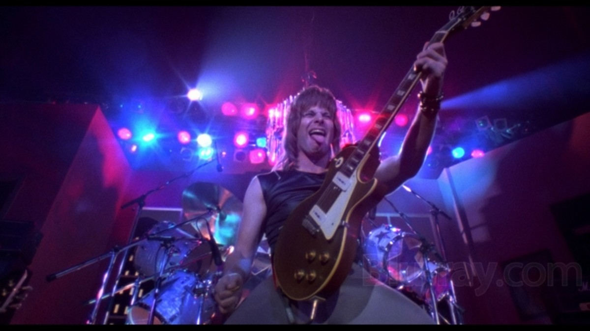 The film pierces the insanity and pomposity of rock band documentaries and performances like a safety pin to a balloon.