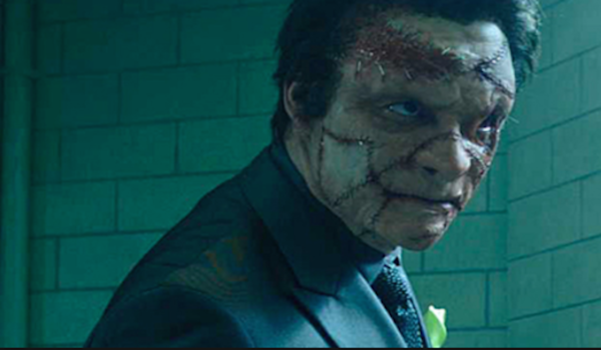 West is almost unrecognisable as the disfigured Jigsaw who brings the franchise the brutality it has been craving.