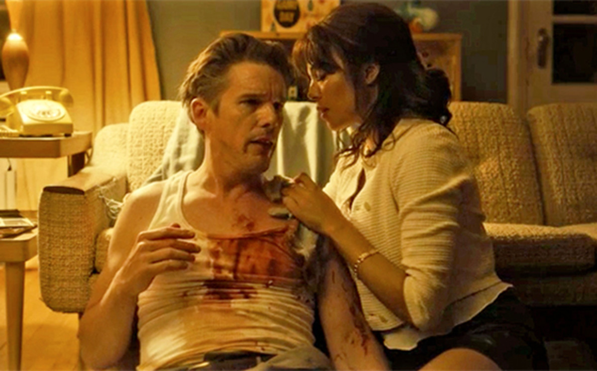 Ethan Hawke as a badly beaten Baker after he couldn't pay up for a heroin transaction. At right is Carmen Ejogo as his fictional love interest and bedrock of a lover Jane.