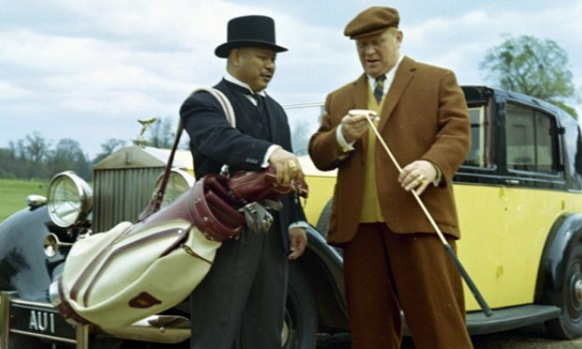 Oddjob (left) - bodyguard, assassin, surprisingly good caddy...