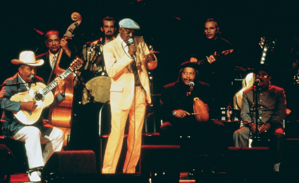 The film intersperses concert footage with interviews with many of the performers including Ibrahim Ferrer (centre).